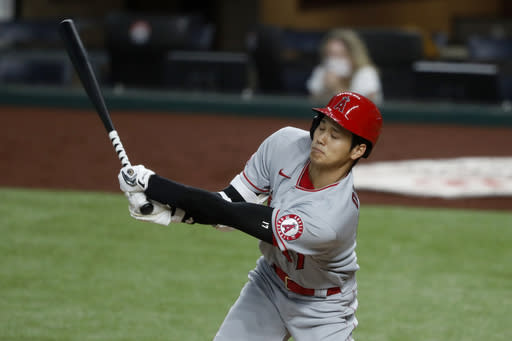 Los Angeles Angels' Shohei Ohtani swings at a pitch from Texas Rangers' Edinson Volquez in the sixth inning of a baseball game in Arlington, Texas, Saturday, Aug. 8, 2020. Ohtani grounded out to first in the at-bat. (AP Photo/Tony Gutierrez)