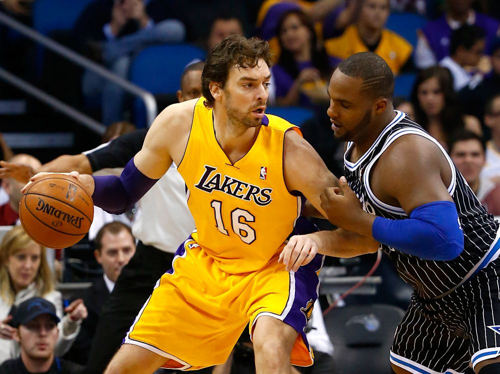 Pau Gasol (L) of the Los Angeles Lakers during a game against the Orlando Magic at Amway Center on January 24, 2014