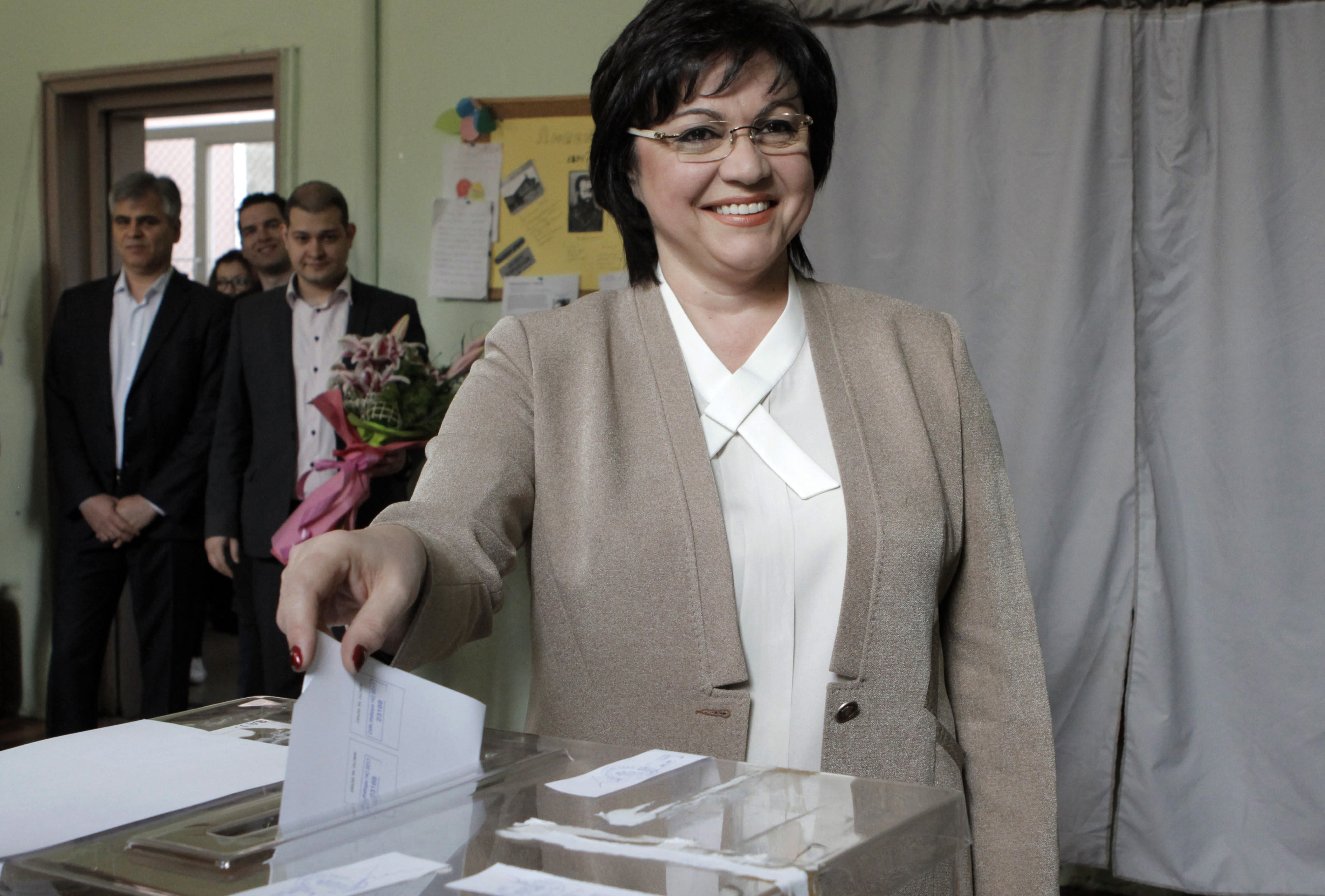 Bulgarian Socialists' Party leader Kornelia Ninova smiles as she casts her vote in Sofia on Sunday, March 26, 2017. Bulgarians are heading to the polls for the third time in four years in a snap vote that could tilt the European Union's poorest member country closer to Russia as surveys put the GERB party neck-and-neck with the Socialist Party. (AP Photo/Valentina Petrova)