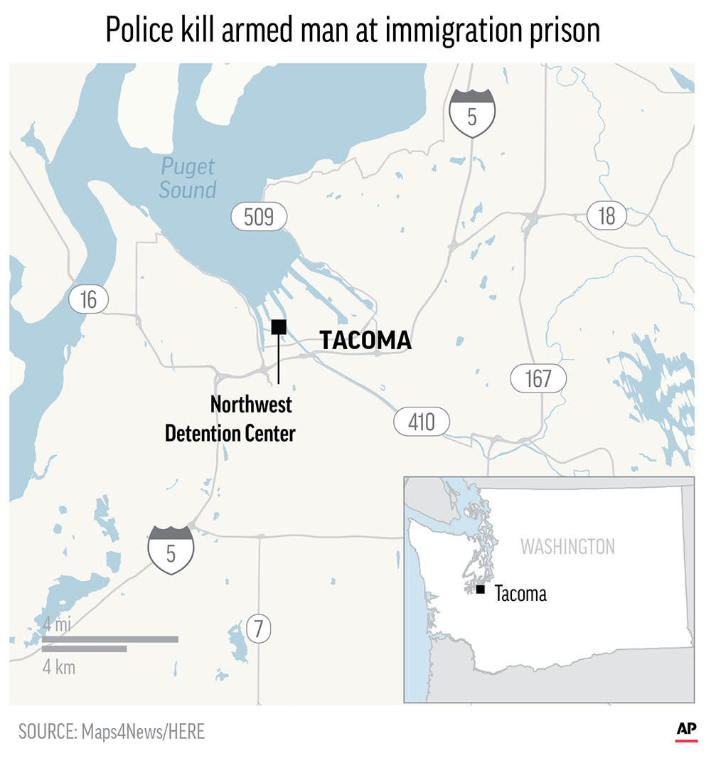 Armed man dies after attacking immigration prison in Tacoma, police say