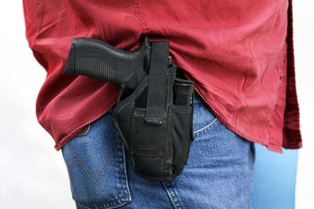 A member of Open Carry Texas openly carries a firearm in Houston