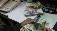 Pakistani rupee tumbles in likely devaluation as central bank backs new rate