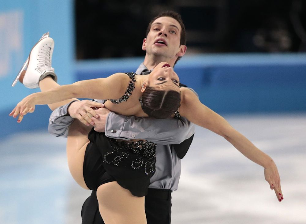 Marissa Castelli and Simon Shnapir of the United States compete in the pairs free skate figure skating competition at the Iceberg Skating Palace during the 2014 Winter Olympics, Wednesday, Feb. 12, 2014, in Sochi, Russia