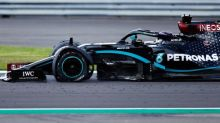Lewis Hamilton hangs on to win British Grand Prix after puncture drama