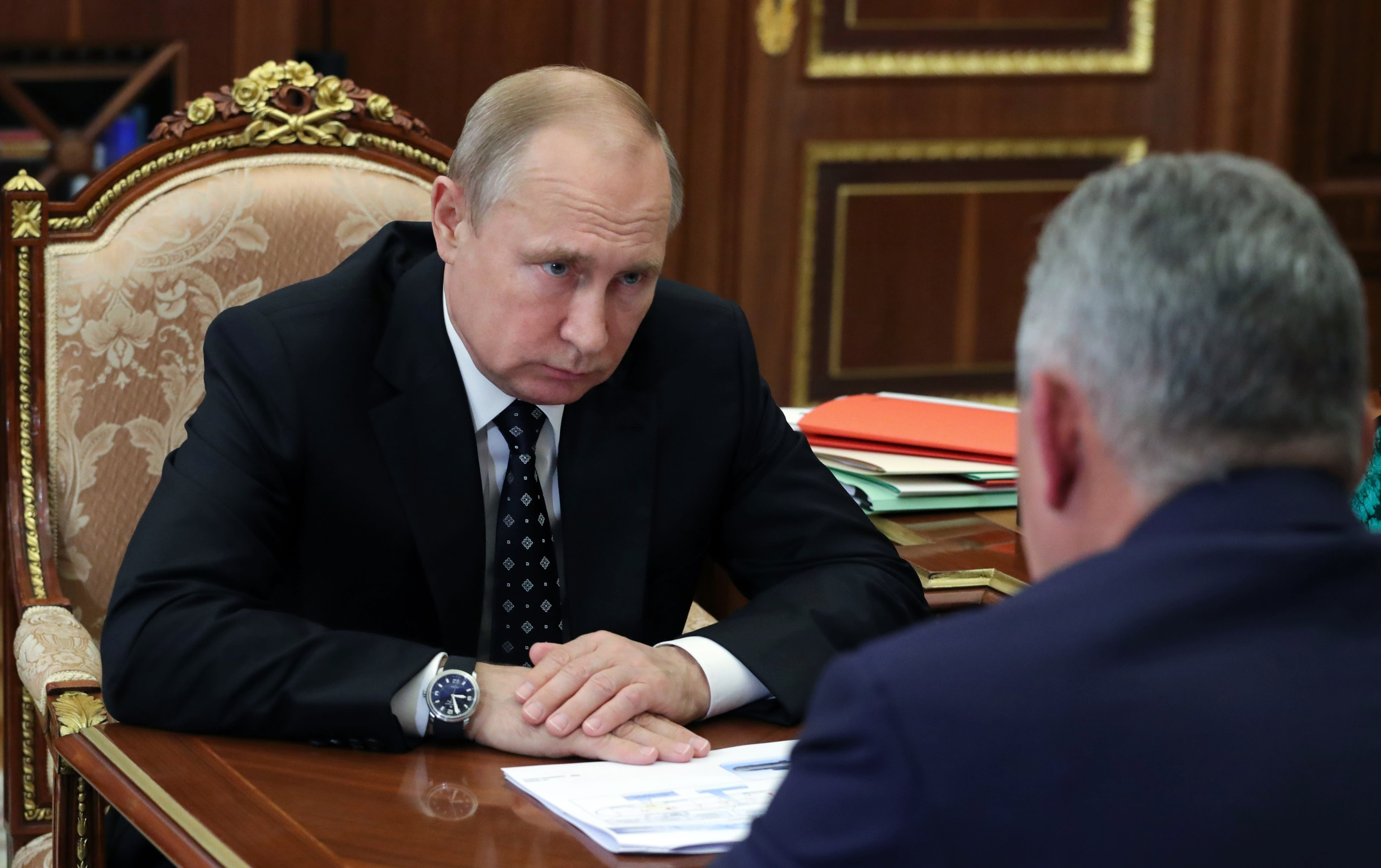Russian President Vladimir Putin, left, listens to Russian Defense Minister Sergei Shoigu during their meeting in the Kremlin in Moscow, Russia, Thursday, July 4, 2019. Some crew members survived a fire that killed 14 sailors on one of the Russian navy's deep-sea submersibles, Russia's defense minister said Wednesday without specifying the number of survivors from the blaze. (Mikhail Klimentyev, Sputnik, Kremlin Pool Photo via AP)