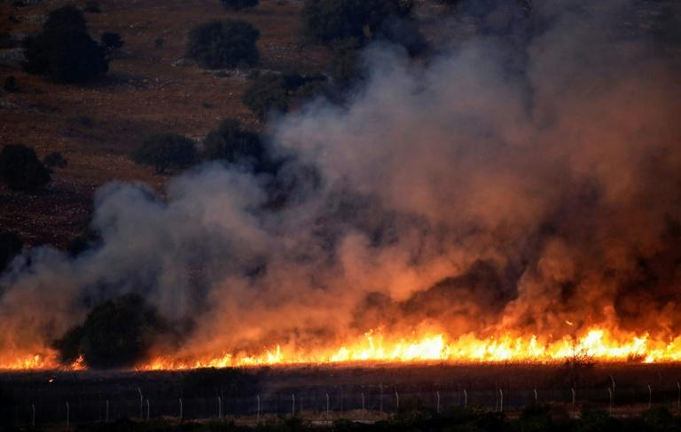 A fire rages in a field in southern Lebanon along the border with Israel on September 1, 2019 after an exchange of fire between Hezbollah and the Israeli army following a week of rising tensions (AFP Photo/JALAA MAREY)