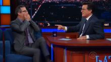 Stephen Colbert Mercilessly Grills John Oliver About Pending Lawsuit He Can't Discuss