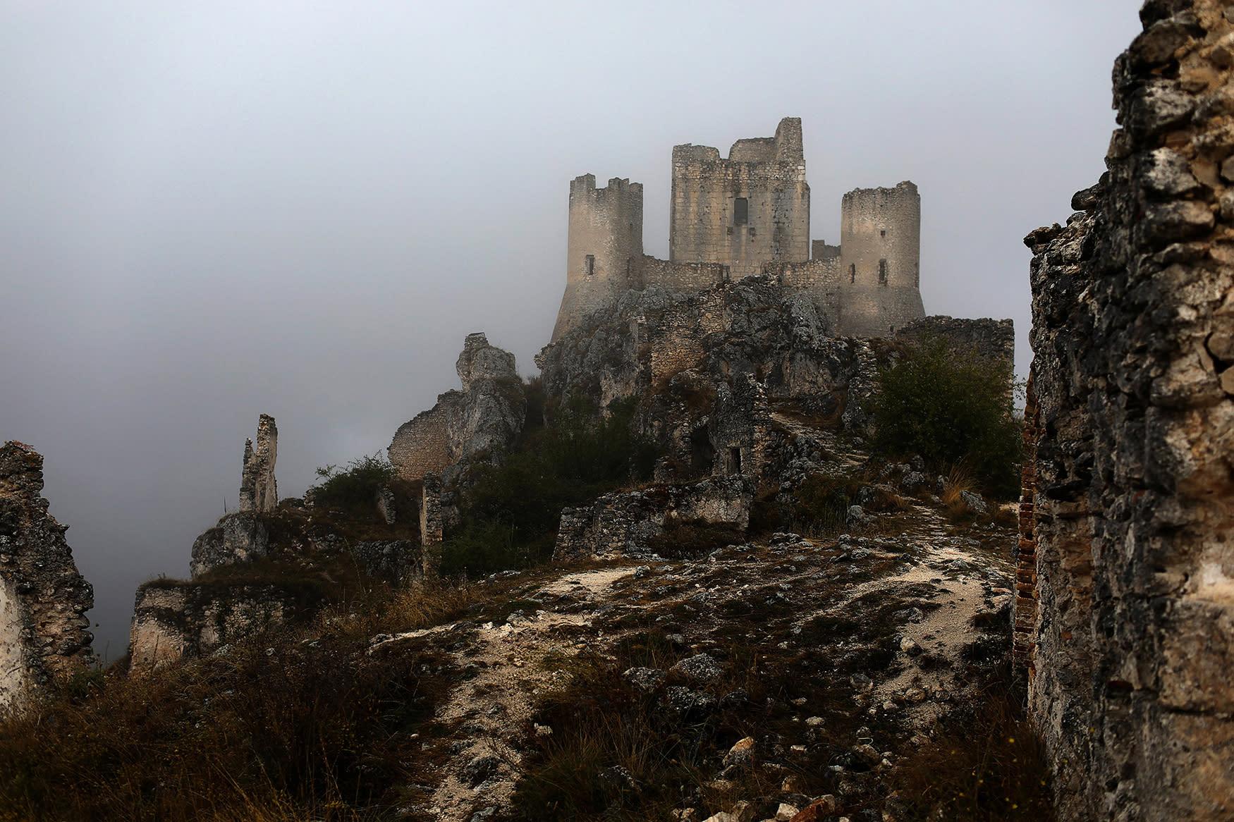 <p>The ruins of a castle stand above the town of Rocca Calascio, close to Santo Stefano di Sessanio in the province of L'Aquila in Abruzzo, inside the national park of the Gran Sasso e Monti della Laga, Italy, September 7, 2016. (Photo: Siegfried Modola/Reuters) </p>