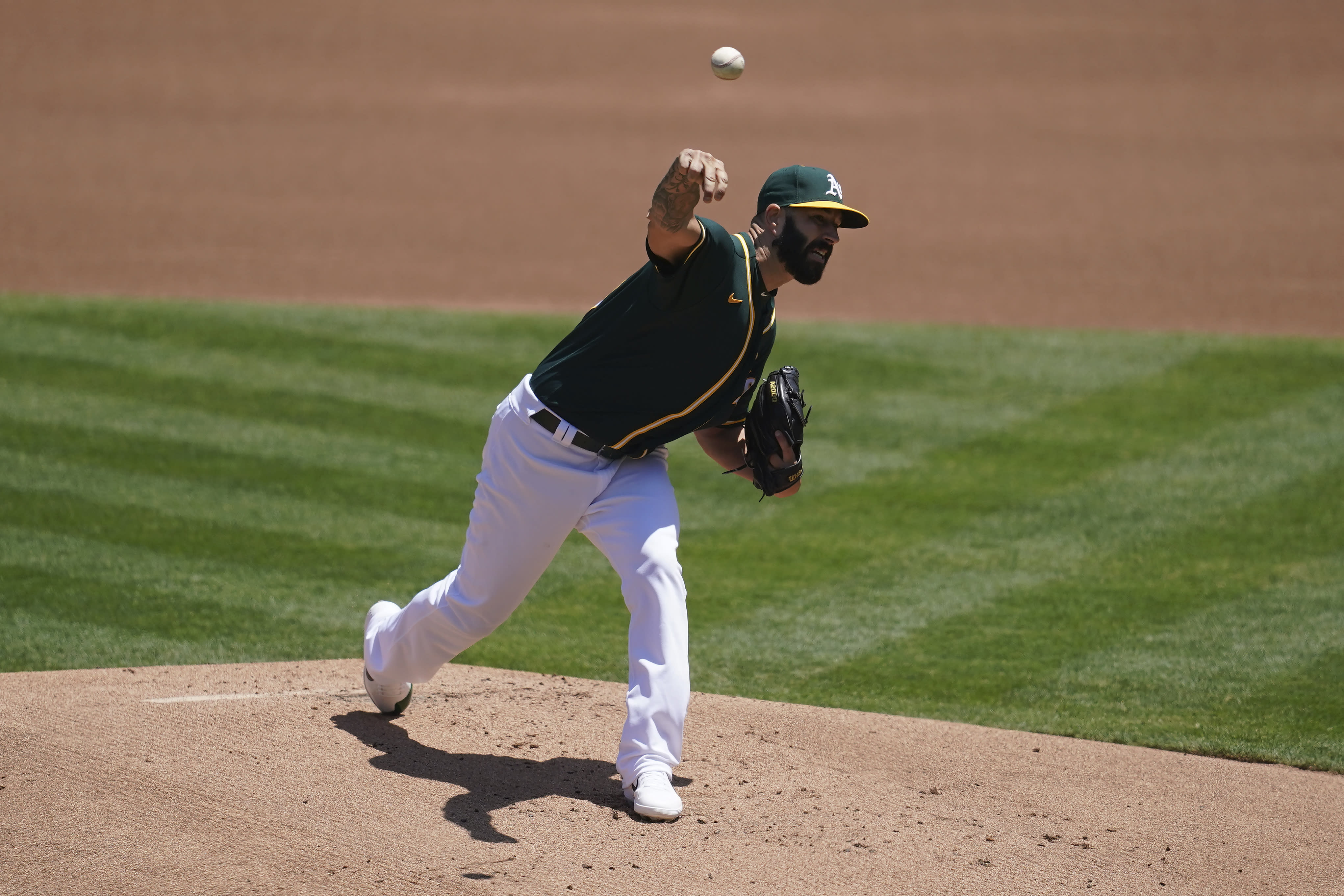 Oakland Athletics pitcher Mike Fiers throws against the Los Angeles Angels during the first inning of a baseball game in Oakland, Calif., Sunday, July 26, 2020. (AP Photo/Jeff Chiu)