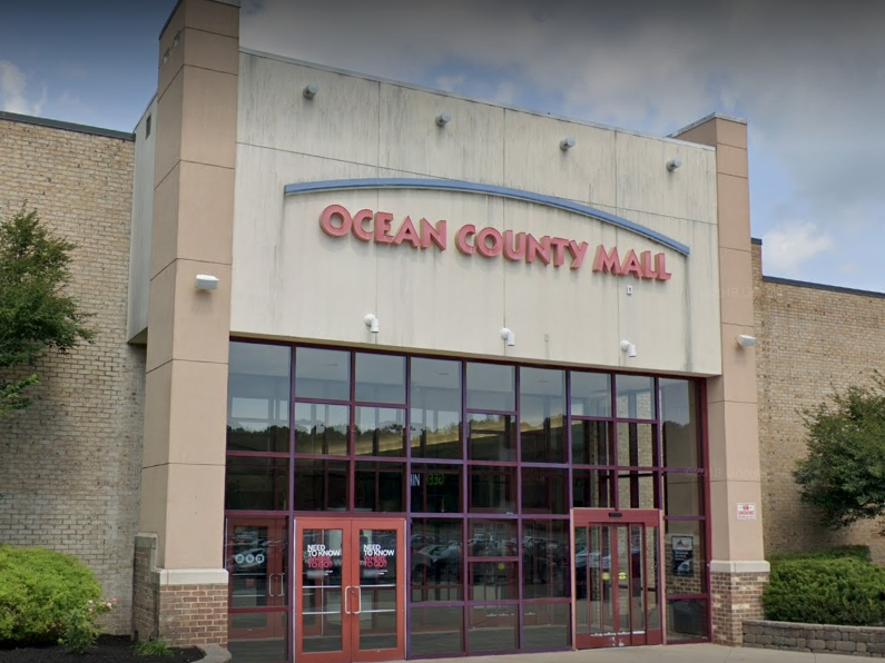 Authorities are searching for two people who hit and spit at an Ocean County Mall store employee last week after she asked them to cover their faces with their masks.