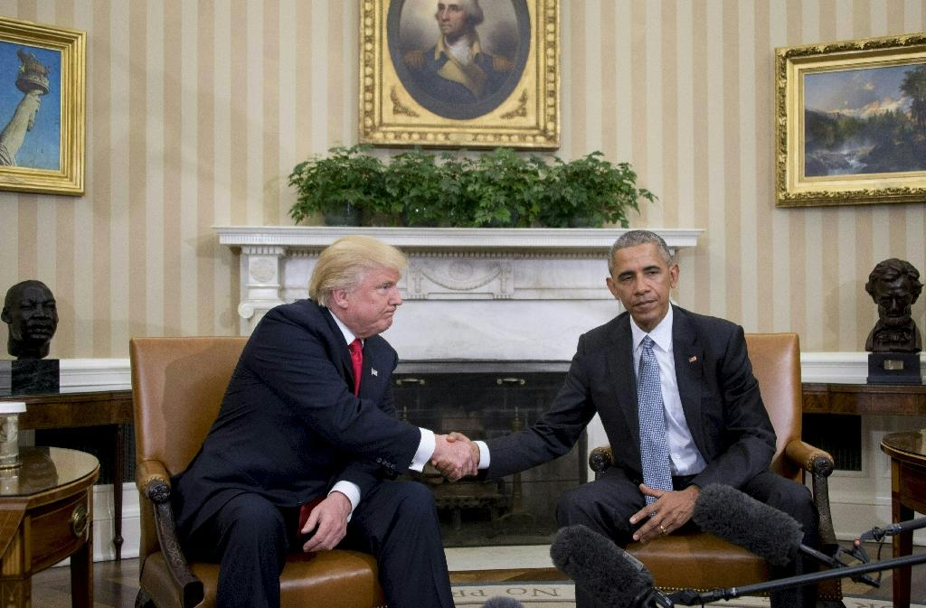 US President Barack Obama shakes hands with President-elect Donald Trump in the Oval Office at the White House on November 10, 2016