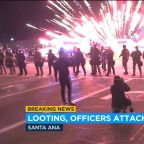 Protesters toss fireworks at police officers in Santa Ana