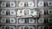 Dollar dives after U.S. Federal Reserve cuts interest rates to battle coronavirus