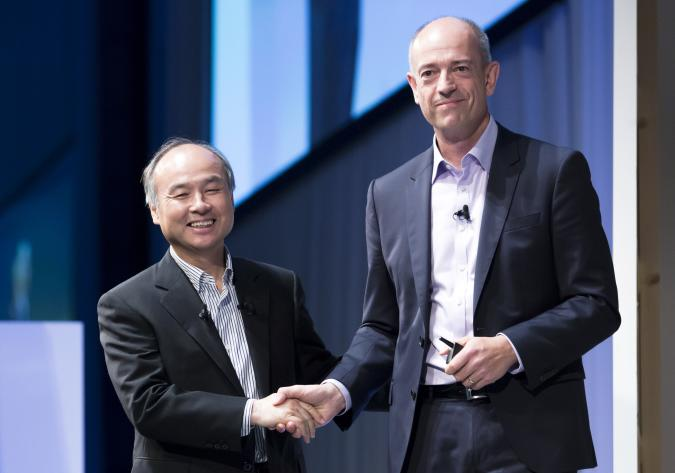 TOKYO, JAPAN - JULY 20:  SoftBank Group Corp. Chief Executive Officer Masayoshi Son, left, shakes hands with ARM Holdings Plc Chief Executive Officer Simon Segars during the SoftBank World 2017 conference on July 20, 2017 in Tokyo, Japan. With 70 speeches and sessions, the annual business event hosted by SoftBank, Japan's multinational telecommunications and internet company, takes place for 2 days until July 21. (Photo by Tomohiro Ohsumi/Getty Images)