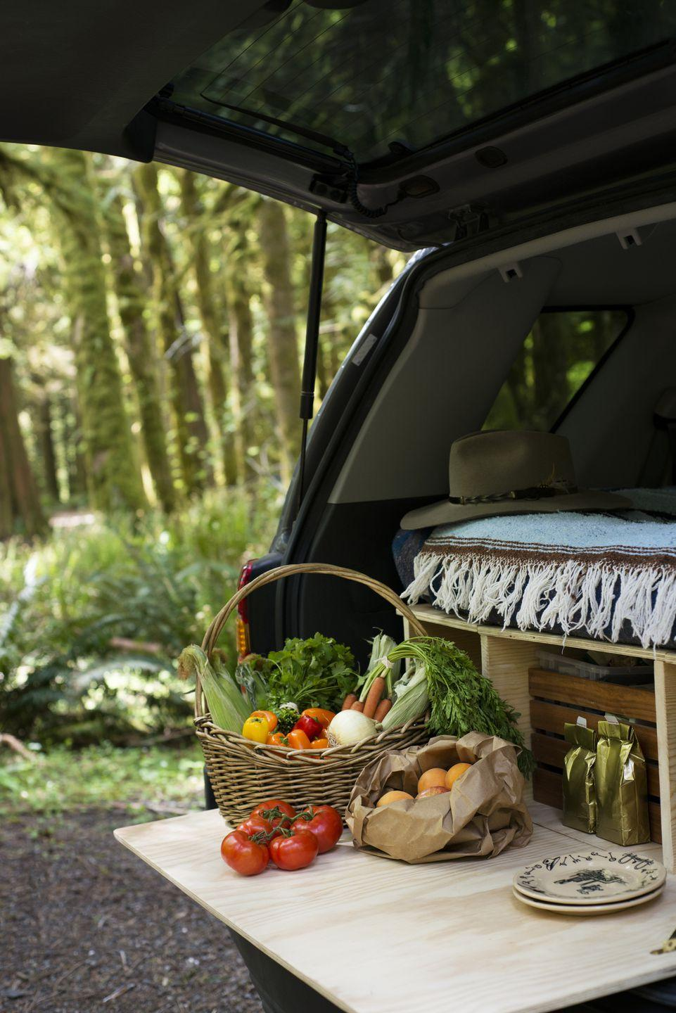 <p>Eating on the go doesn't necessarily have to equate to fast food from the car and/or rest stops. Make the most of your car-to-table dining experience by elongating your trunk with a slab of wood (which you can store beneath your luggage and supplies), then tuck into some fresh produce. You can even DIY an enclosed wood storage unit to fit the width of your trunk, then convert the lid into a sturdy table. </p>