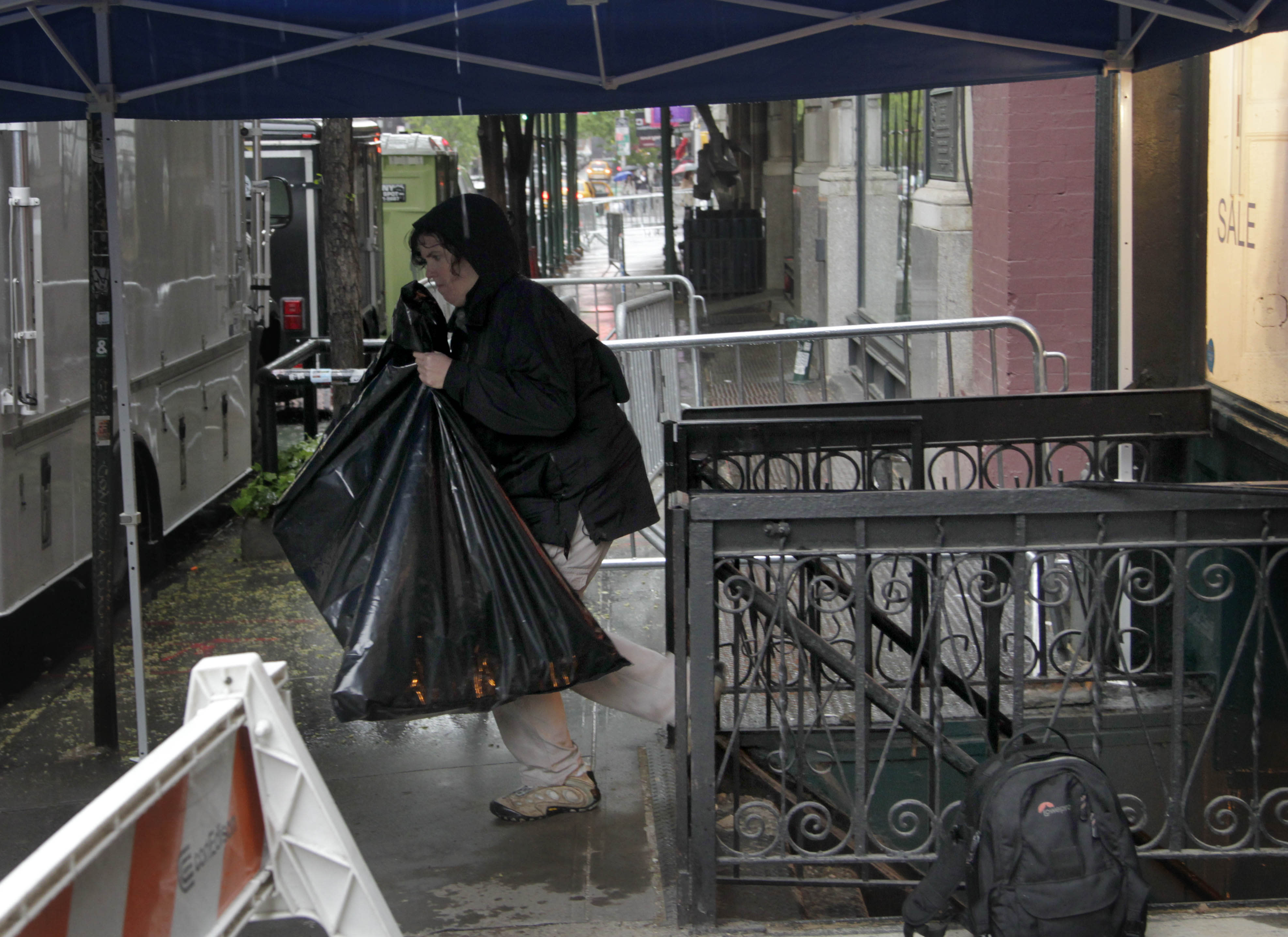 An investigator brings bags out of a basement that the Federal Bureau of Investigation is investigating in connection to the 1979 disappearance of 6-year-old boy Etan Patz in New York, Sunday, April 22, 2012. Heavy rains expected in the region halted the investigation on Sunday, but work in the basement is expected to resume Monday morning. (AP Photo/Seth Wenig)