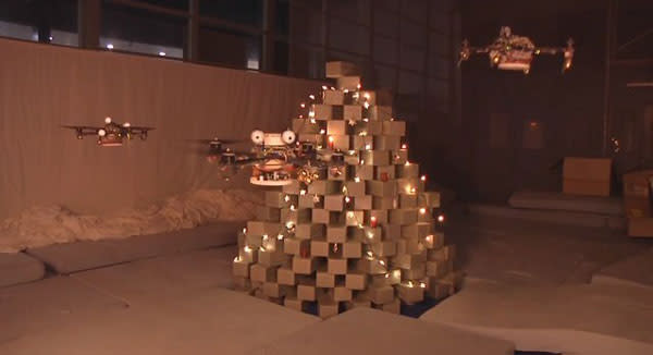 Quadrocopters don creepy eyes, build synthetic Christmas tree of envy (video)