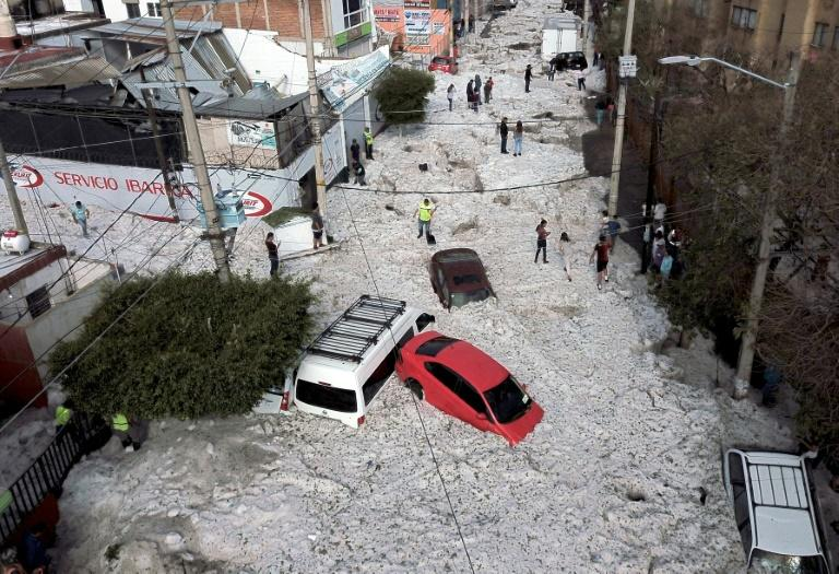 A freak heavy hail storm damaged buildings and buried cars and trucks in the area around Guadalajara, Mexico (AFP Photo/ULISES RUIZ)