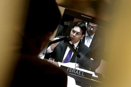 Israel's Ambassador to the United Nations Danny Danon is seen on a screen in an interpreters booth as he addresses a United Nations Security Council meeting on the Middle East at U.N. headquarters in New York, January 26, 2016. REUTERS/Mike Segar
