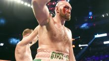 Bloodied Tyson Fury survives scare in gruesome showdown