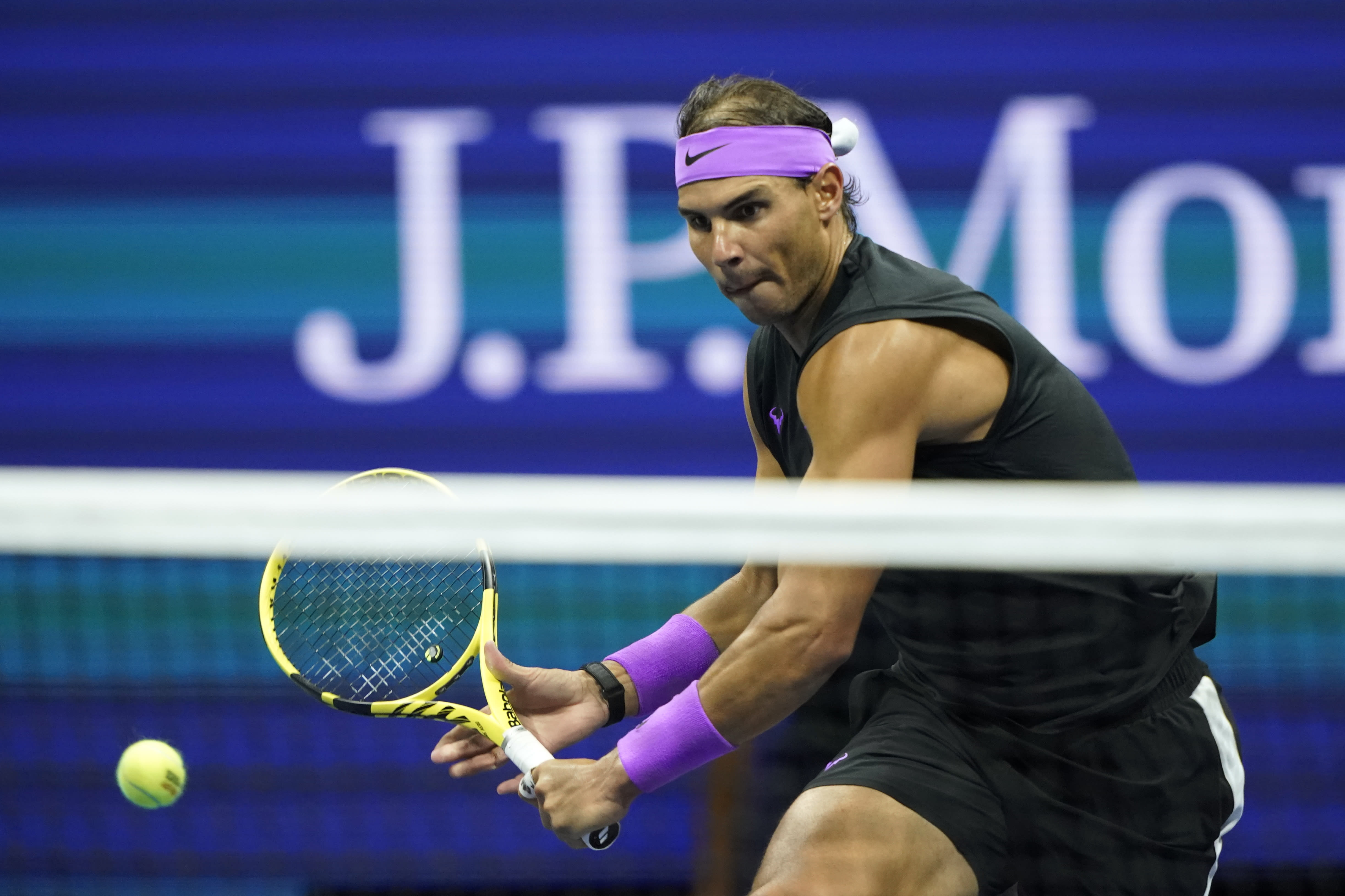 Rafael Nadal, of Spain, returns a shot to Matteo Berrettini, of Italy, during the men's singles semifinals of the U.S. Open tennis championships Friday, Sept. 6, 2019, in New York. (AP Photo/Eduardo Munoz Alvarez)