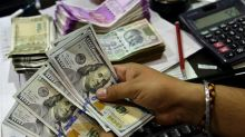 Rupee Trades Lower After Opening Flat