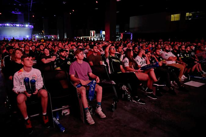 Jul 20, 2019; Miami Beach, FL, USA; Fans in attendance watch the game play between Faze Clan and 100 Thieves during the Call of Duty League Finals e-sports event at Miami Beach Convention Center. Mandatory Credit: Jasen Vinlove-USA TODAY Sports