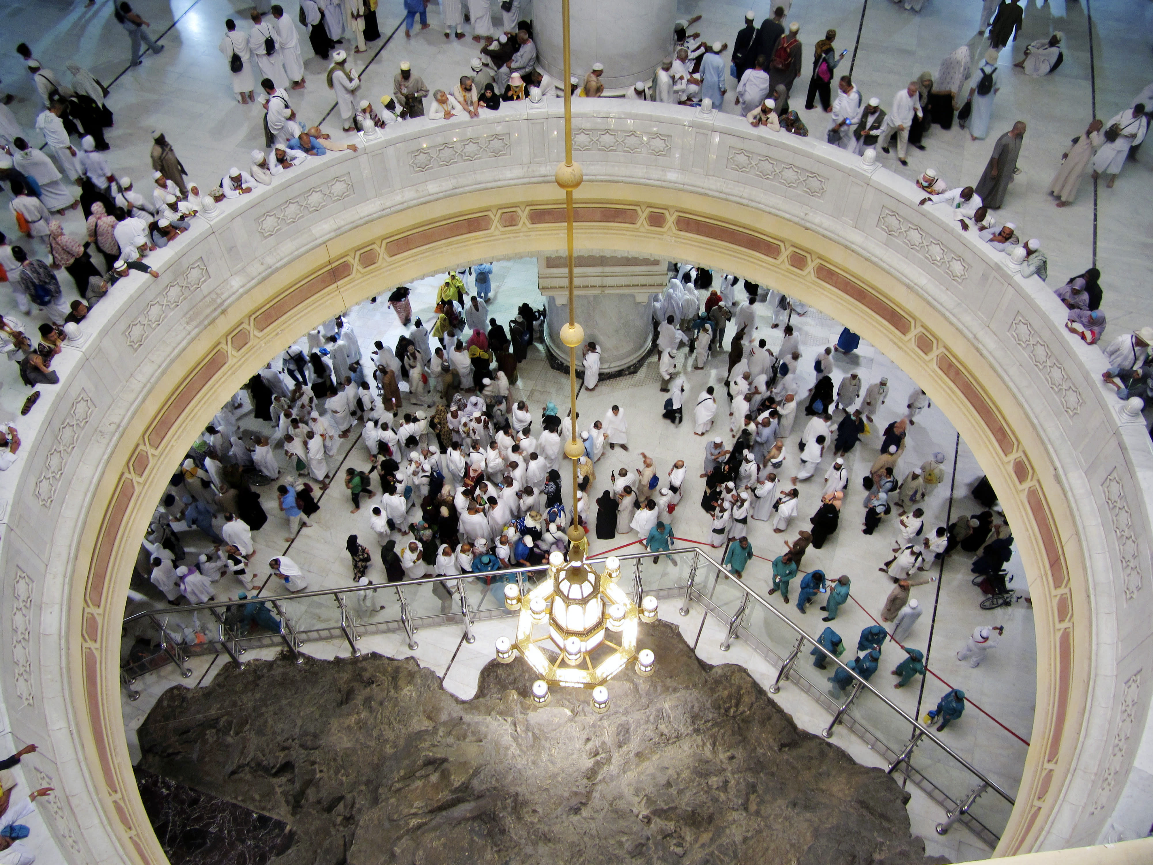 """FILE - In this Aug. 9, 2019 file photo pilgrims pray near the Al-Safa mountain, at the Grand Mosque, during the Hajj pilgrimage in the Muslim holy city of Mecca, Saudi Arabia. Saudi Arabia said Tuesday, June 22, 2020 this year's hajj will not be canceled, but that due to the coronavirus only """"very limited numbers"""" of people will be allowed to perform the pilgrimage that traditionally draws around 2 million people from around the world to Mecca once a year. (AP Photo/Amr Nabil, file)"""