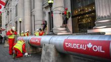 Greenpeace protesters build massive pipeline around London's Canadian High Commission