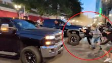 Trump fans filmed driving through crowds and macing demonstrators