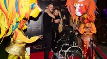 Katie Price hits the red carpet in her wheelchair after stitches removal on broken feet