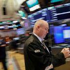 Apple, Philip Morris, chips lead slide on Wall Street