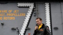 Dismissed U.S. carrier captain gets hero's ovation from crew