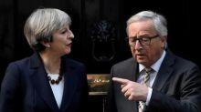May, Juncker aides in Twitter spat over dinner leaks