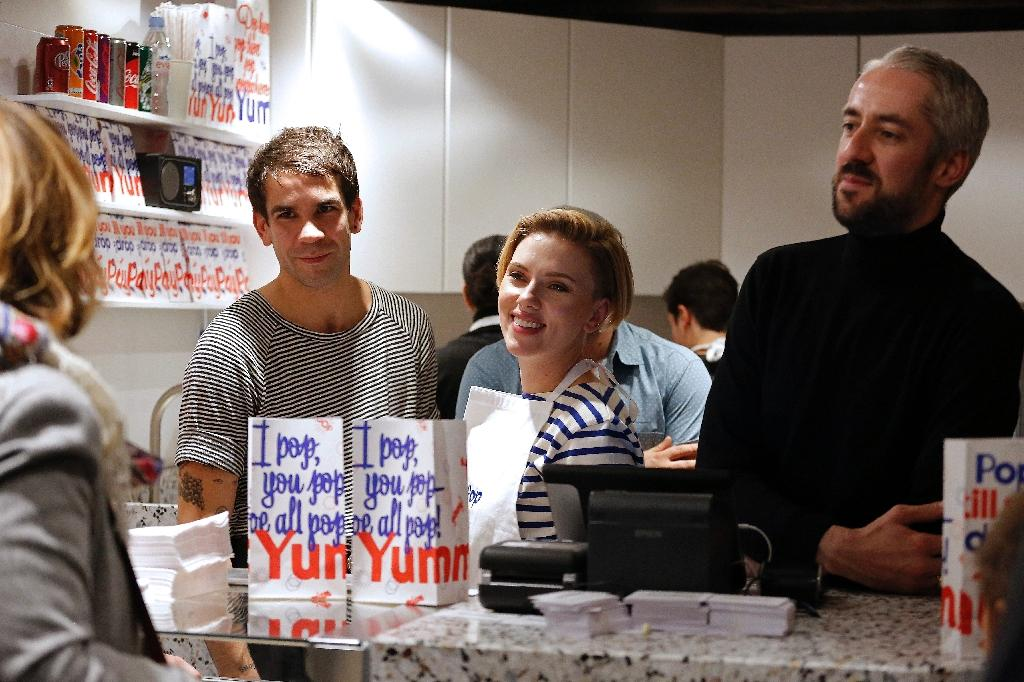 US actress Scarlett Johansson and her husband Romain Dauriac (L) attend the opening of the Yummy Pop gourmet popcorn shop in the Marais district of Paris on October 22, 2016