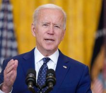 Biden news - live: President plays golf for first time in office as woman charged with threatening VP Harris