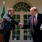 Trump forges bond with Brazil's Bolsonaro in White House visit
