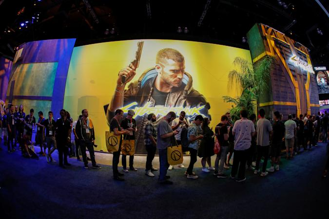 Attendees wait in line at the Cyberpunk 2077 booth during the opening day of E3, the annual video games expo revealing the latest in gaming software and hardware in Los Angeles, California, U.S., June 11, 2019.  REUTERS/Mike Blake
