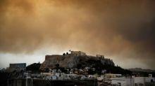 Greeks flee wildfire raging west of Athens