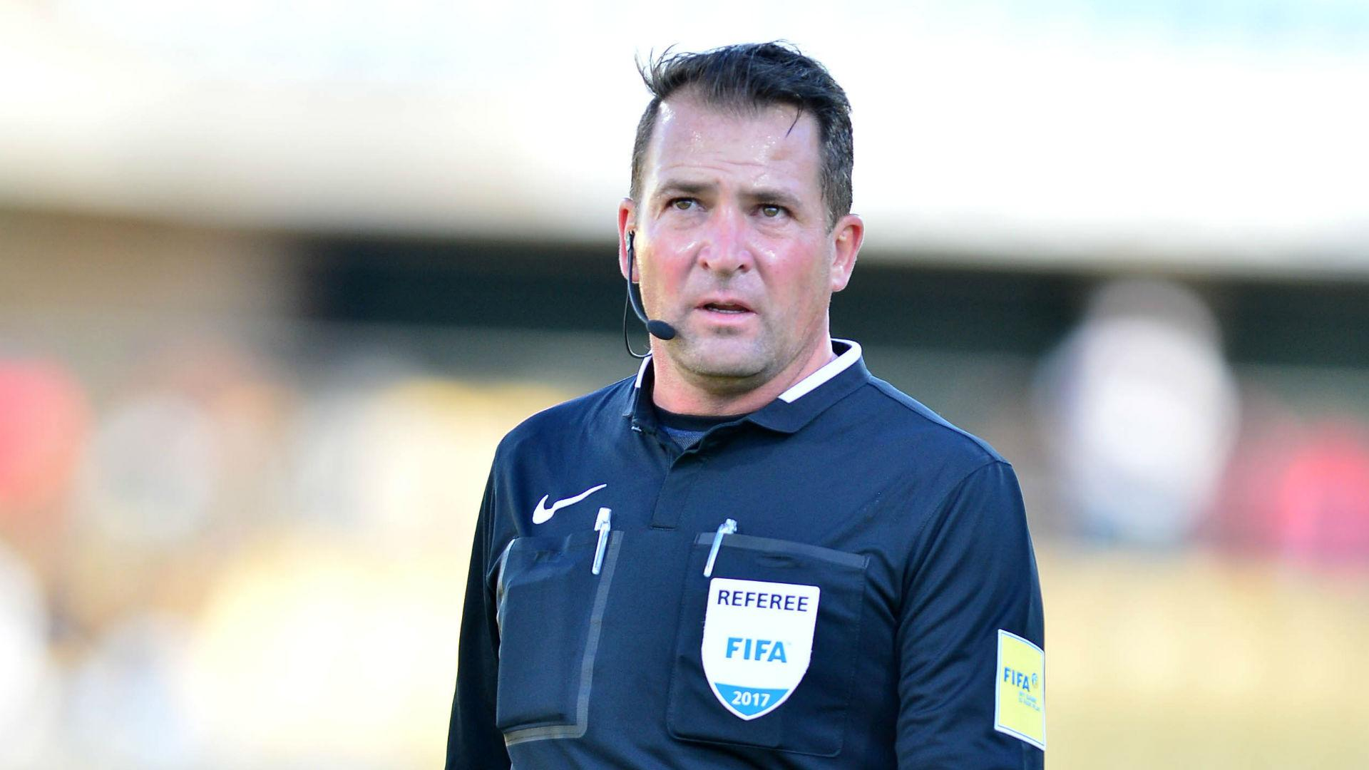 South African referee Daniel Bennett hangs his whistle from the international scene