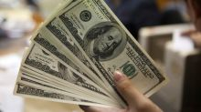 Dollar jumps, recovers post-Fed losses