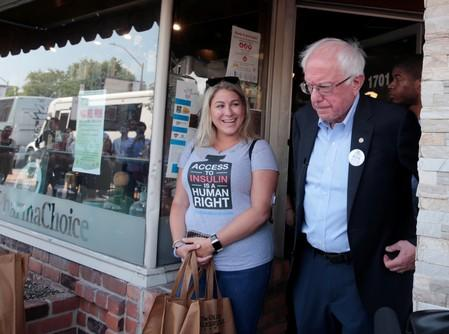 Sanders leads group to Canada