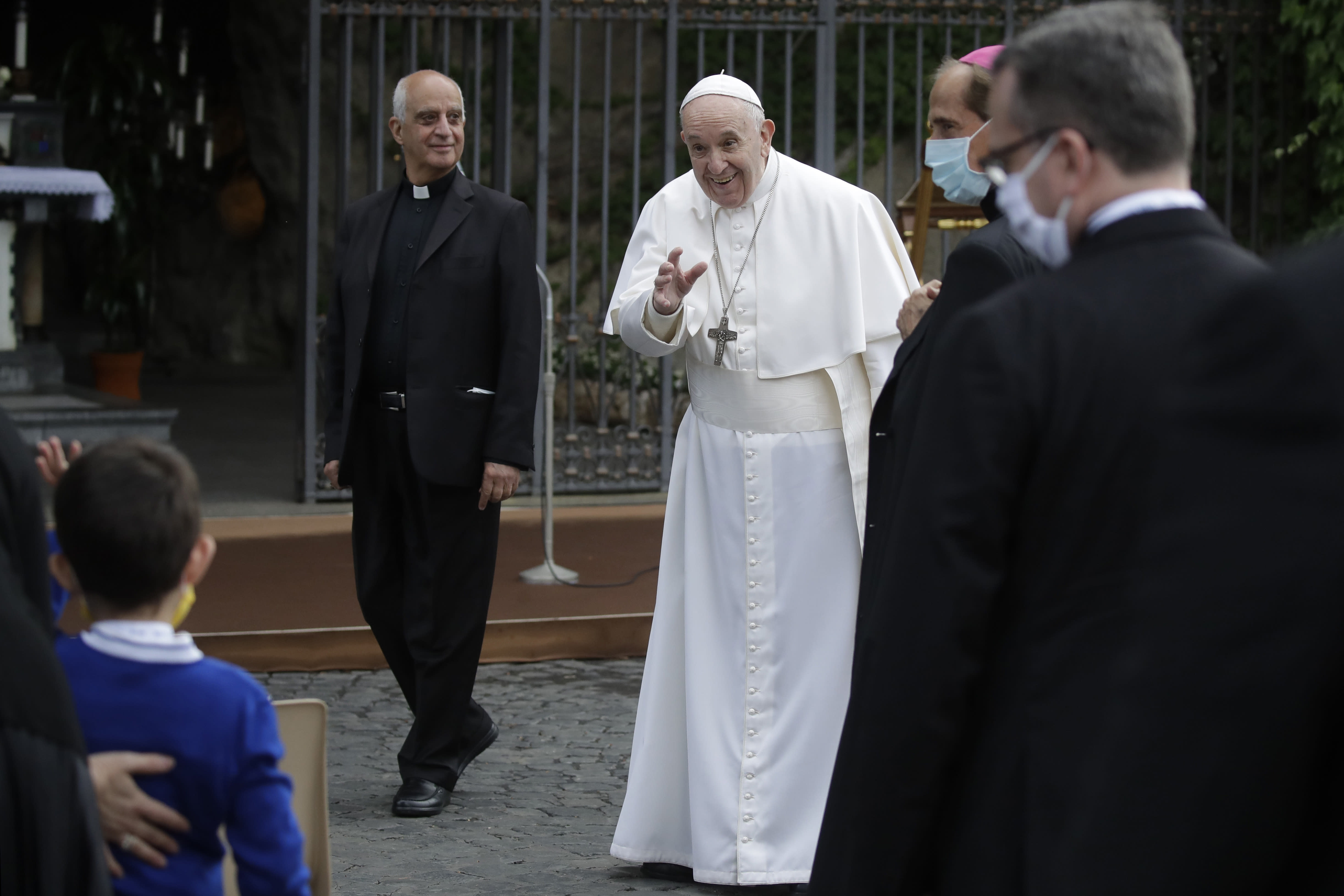 Pope Francis waves as he leaves after a rosary in Vatican gardens Saturday, May 30, 2020. Pope Francis is reciting a special prayer for the end of the coronavirus pandemic surrounded by a representative sampling of people on the front lines in his biggest post-lockdown gathering to date. (AP Photo/Alessandra Tarantino, pool)