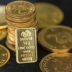 Gold subdued as investors await FOMC minutes