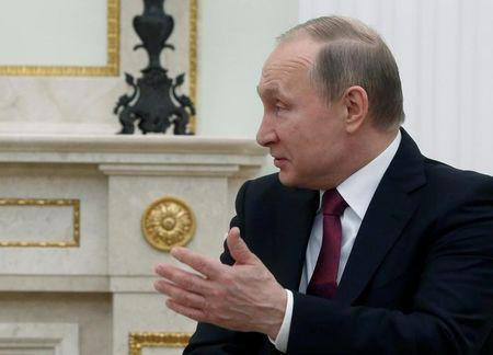 Russian President Vladimir Putin talks to Italian President Sergio Mattarella during their meeting at the Kremlin in Moscow, Russia April 11, 2017. REUTERS/Sergei Chirikov/Pool