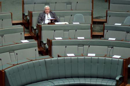 Australian politician Clive Palmer waits to make an announcement in the House of Representatives at Parliament House in Canberra