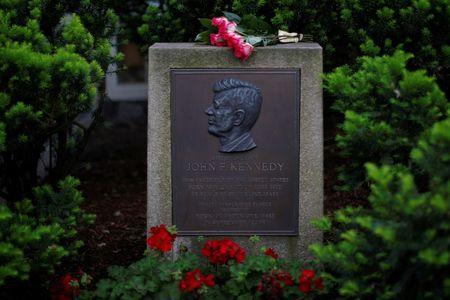 Roses lie on a marker outside the home where President John F. Kennedy was born 100 years ago on May 29, 1917, in Brookline