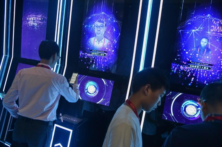 China's AI technology companies are rising stars -- here people have their faces scanned at the World Artificial Intelligence Conference in Shanghai (AFP Photo/HECTOR RETAMAL)