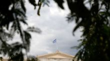 Euro zone finance ministers reach debt relief deal on Greece