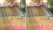 Mind the gap: Shocking video shows cyclist disappearing into gap of rising bridge